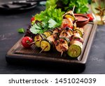 grilled meat skewers  chicken ... | Shutterstock . vector #1451024039