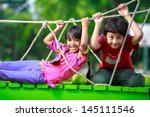 happy asian child playing... | Shutterstock . vector #145111546