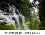 Waterfalls Cascading Over Rock...