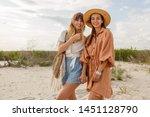 two lovely carefree women...   Shutterstock . vector #1451128790