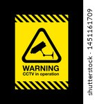 a cctv in operation warning sign | Shutterstock .eps vector #1451161709