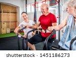 senior couple biking at the gym ...   Shutterstock . vector #1451186273