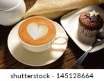 A Cup Of Cafe Latte And Cake