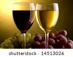 a glass of red and white wine and red and green grape - stock photo