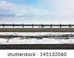 light snow fall blows across... | Shutterstock . vector #145132060