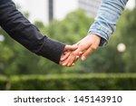 lesbian couple holding hands | Shutterstock . vector #145143910