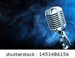 silver microphone closeup on... | Shutterstock . vector #1451486156