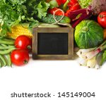 Fresh ripe vegetables with chalk blackboard for text on a white background. - stock photo