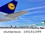 Small photo of Lufthansa hub Munich Airport with satellite terminal building and various Lufthansa and Star alliance partners parked aircrafts on sunny day with blue sky taken on 9 July 2018