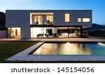 modern villa with pool  night... | Shutterstock . vector #145154056