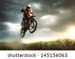 a picture of a biker making a... | Shutterstock . vector #145156063