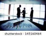 shady image of a business team... | Shutterstock . vector #145160464