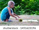 blond caucasian girl rolling...   Shutterstock . vector #1451623196