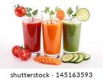 assortment of vegetable juice | Shutterstock . vector #145163593