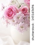 pink and white flowers in a... | Shutterstock . vector #145165696