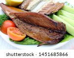 Stock photo smoked mackerel on a plate mackerel with lemon and vegetables 1451685866