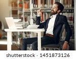 man in a library. guy in a... | Shutterstock . vector #1451873126