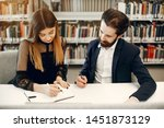 students in a library. guy in a ... | Shutterstock . vector #1451873129