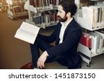 man in a library. guy in a... | Shutterstock . vector #1451873150