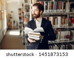 man in a library. guy in a... | Shutterstock . vector #1451873153