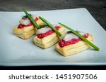 Stock photo closeup snacks with red sauce herring pieces green onion 1451907506