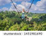 young woman swinging in the... | Shutterstock . vector #1451981690