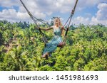 young woman swinging in the... | Shutterstock . vector #1451981693