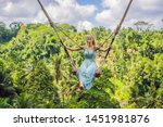young woman swinging in the... | Shutterstock . vector #1451981876