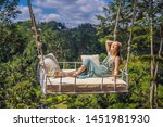 young woman swinging in the... | Shutterstock . vector #1451981930