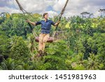 young man swinging in the... | Shutterstock . vector #1451981963