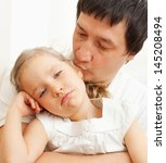 father comforts a sad girl.... | Shutterstock . vector #145208494