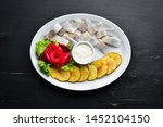 herring with baked potatoes. in ...