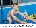 little boy sits in the pool on...   Shutterstock . vector #1452173666