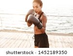 image of focused pretty woman...   Shutterstock . vector #1452189350