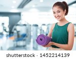 young asian woman holding a...   Shutterstock . vector #1452214139