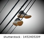 Old Sneakers Hanging From...
