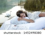 Beautiful Woman Sleeping On A...