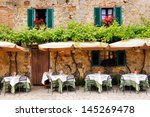 cafe tables and chairs outside... | Shutterstock . vector #145269478