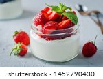 Greek yogurt strawberry and blueberry parfaits with fresh berries. toning. selective focus