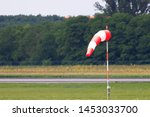 A Single Windsocks At An Airport