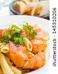 tasty pasta with salmon on a... | Shutterstock . vector #145310206