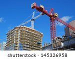 apartment building construction | Shutterstock . vector #145326958