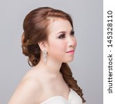 bridal make up and hair style  | Shutterstock . vector #145328110
