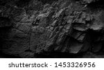 Dark aged shabby cliff face and ...