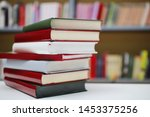 stack of books in library | Shutterstock . vector #1453375256