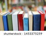 stack of books in library | Shutterstock . vector #1453375259