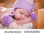 photo baby in the mail box | Shutterstock . vector #145342000