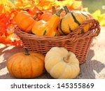 pumpkins in basket. defocused... | Shutterstock . vector #145355869