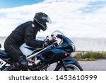 Biker Rides Motorcycle ...