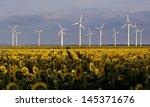sunflowers and wind generators... | Shutterstock . vector #145371676